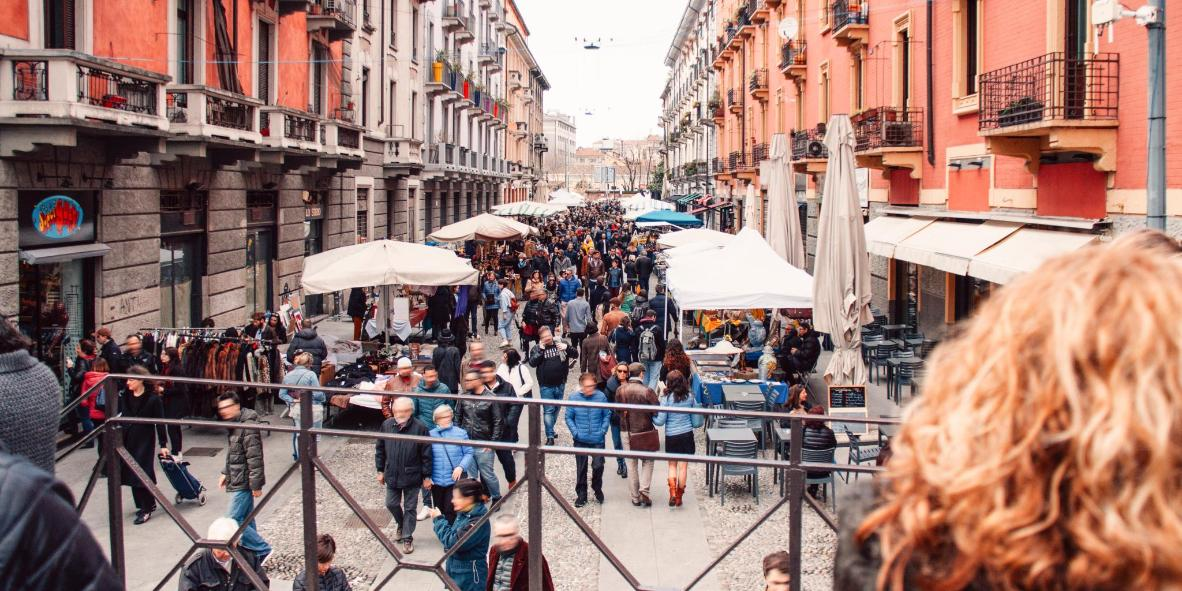 The rosy-hued Via Casale is filled with shoppers on market day