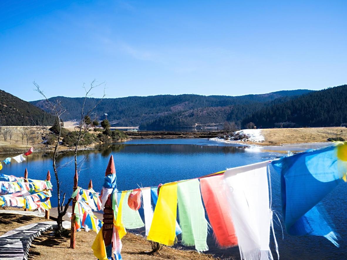 Prayer flags flutter in the wind in Shangri-La City