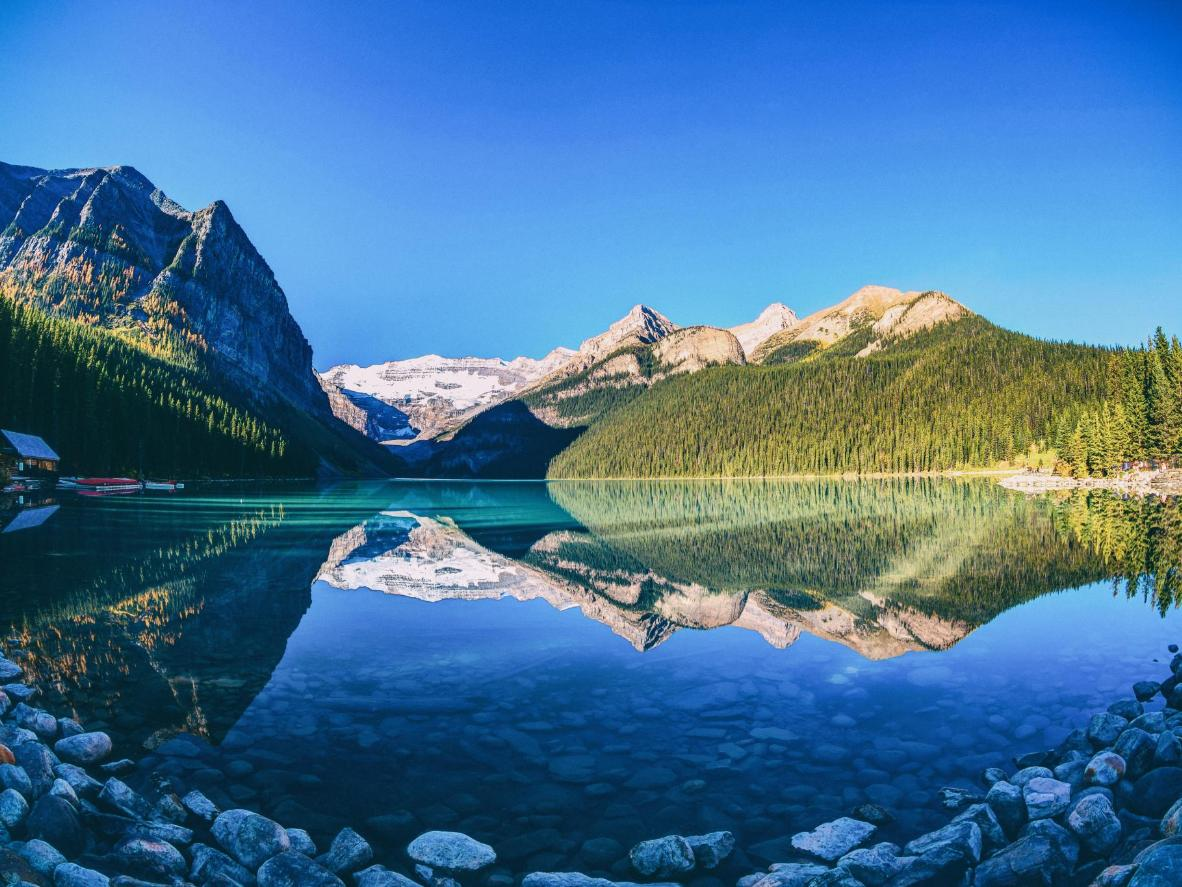 The reflections of mountains on the lakes of Banff National Park are prime Instagram material