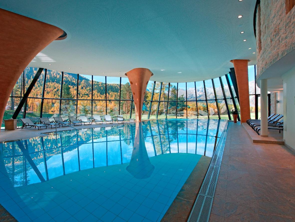 The Grand Hotel Kronenhof's infinity pool boasts dreamlike mountain views