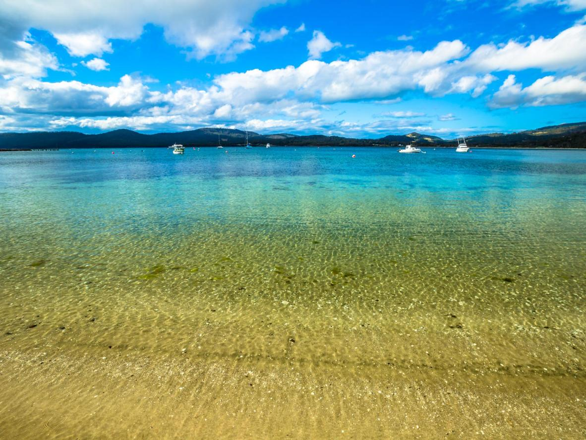 The clear waters of the Tasmanian Coastal Bay