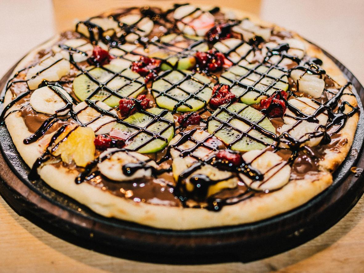 In Brazil you can tuck into a fruity dessert pizza drizzled in chocolate