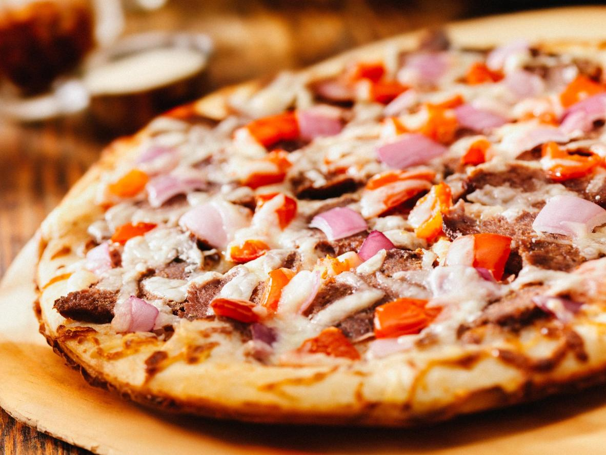 A slice of Swedish pizza is usually topped with plenty of meat