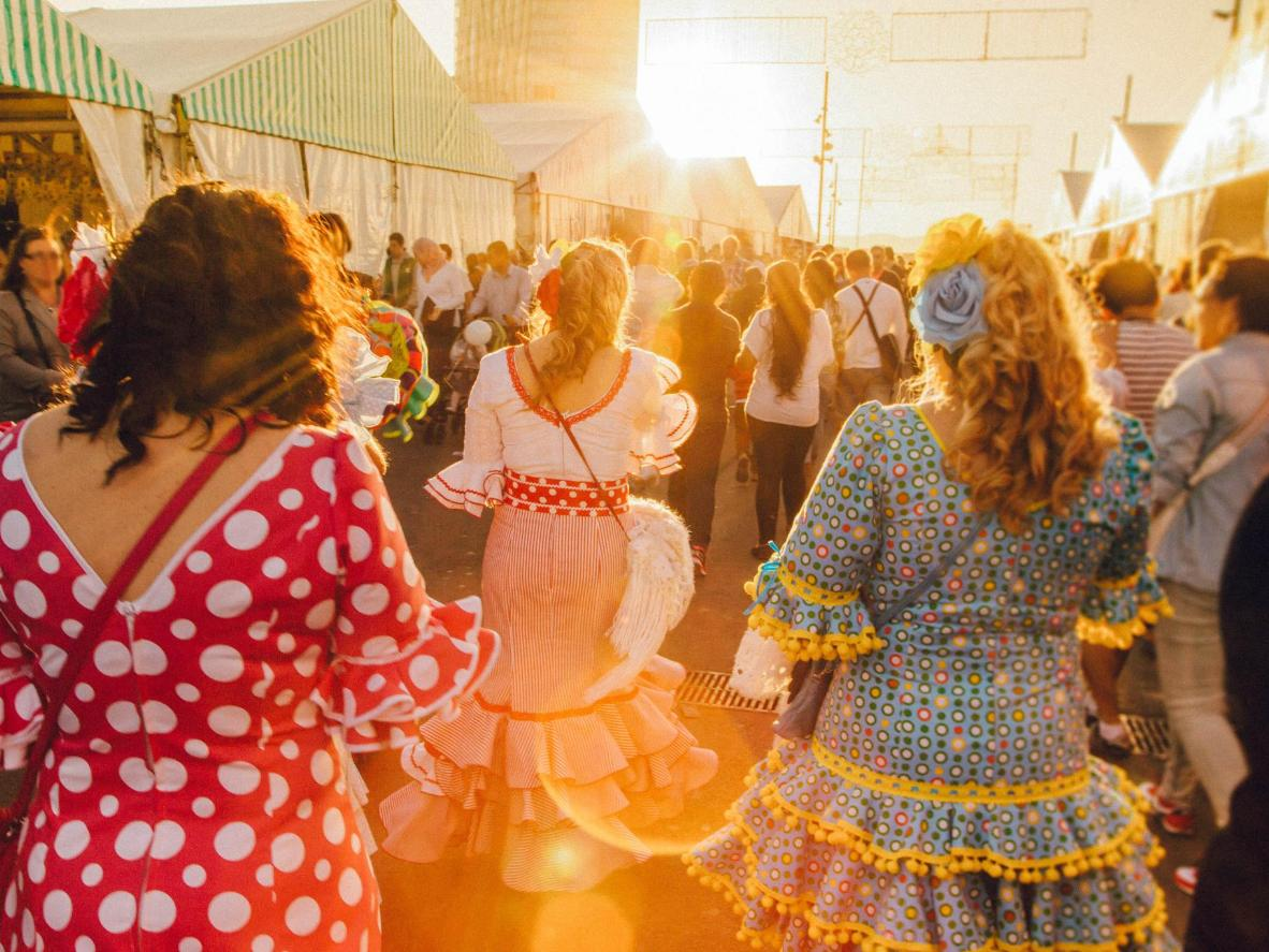 Traditionally-dressed revellers during the Seville Fair, Spain