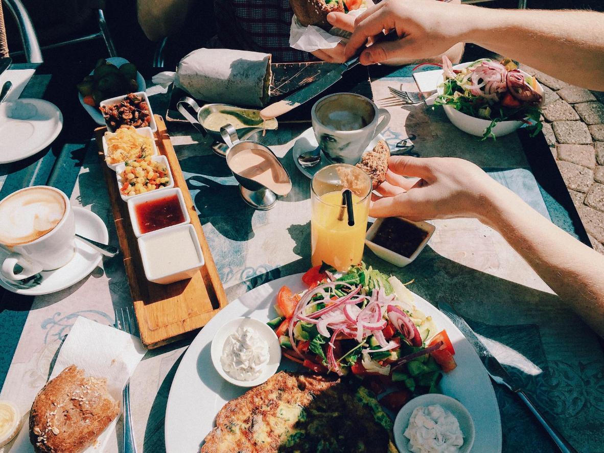 Enjoy typical Tel Aviv sharing food al fresco in spring, Israel