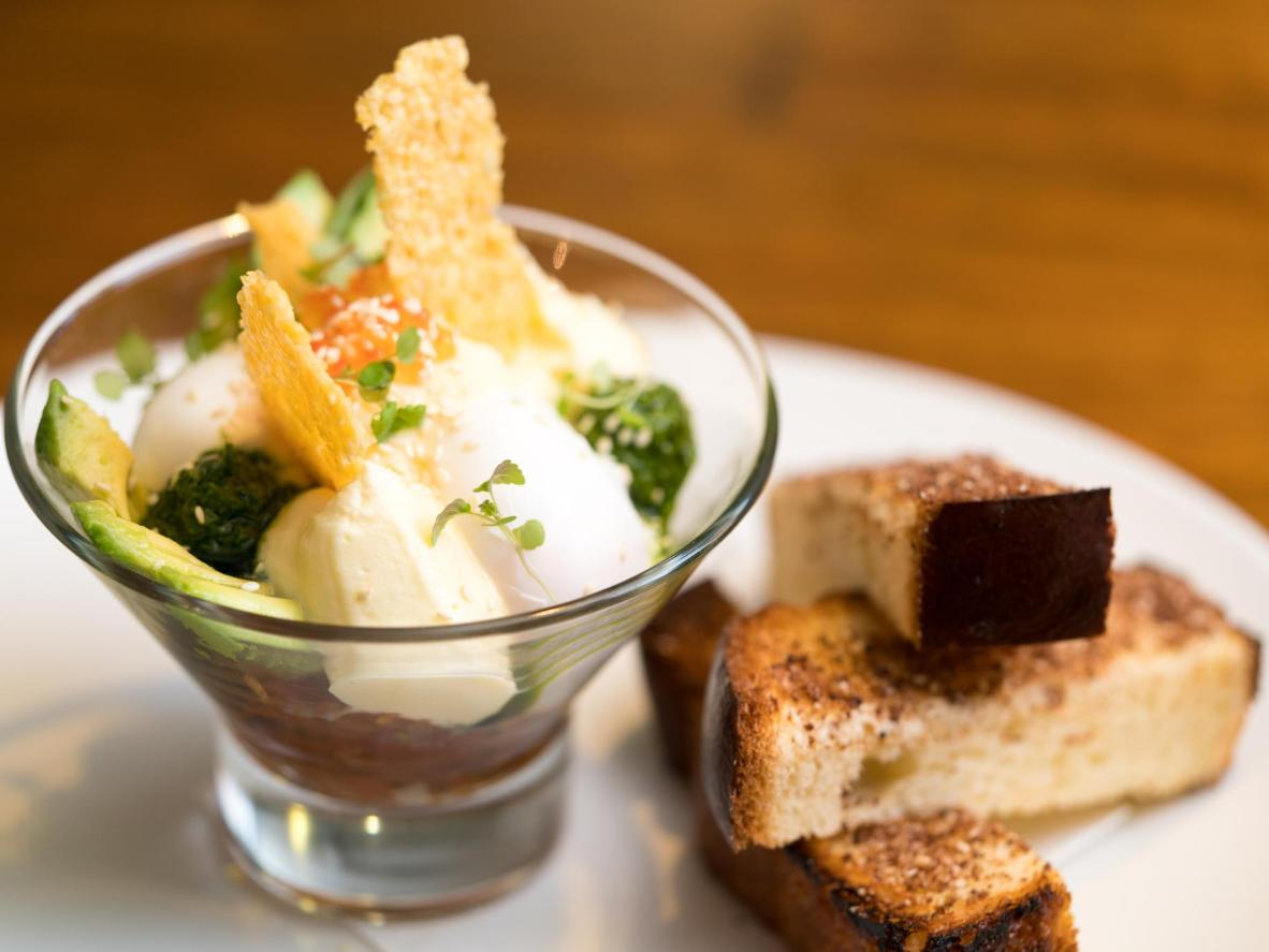 Egg Sundae Royale at the Grain Store, with soft boiled eggs, avocado, parmesan, tomato salsa, and spiced brioche