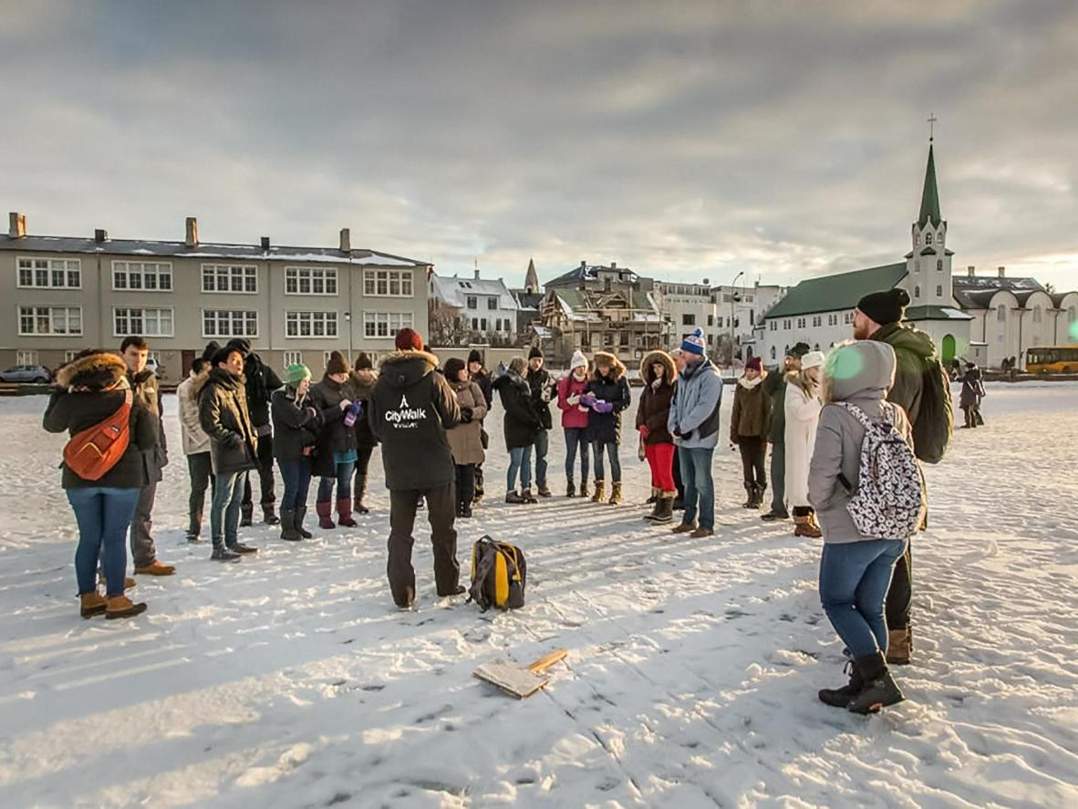 A City Walk tourguide giving a free walking tour in Iceland's capital city