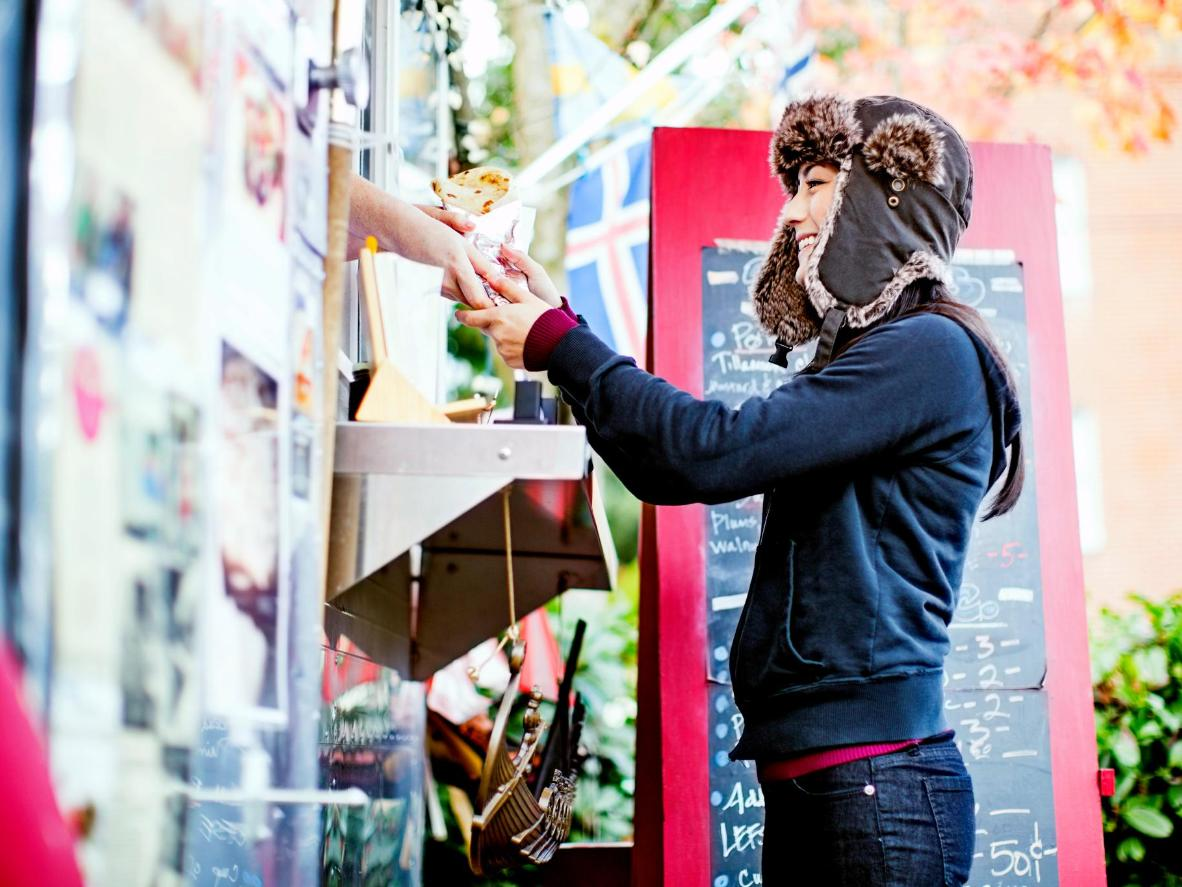 A happy customer at one of the Portland food pods