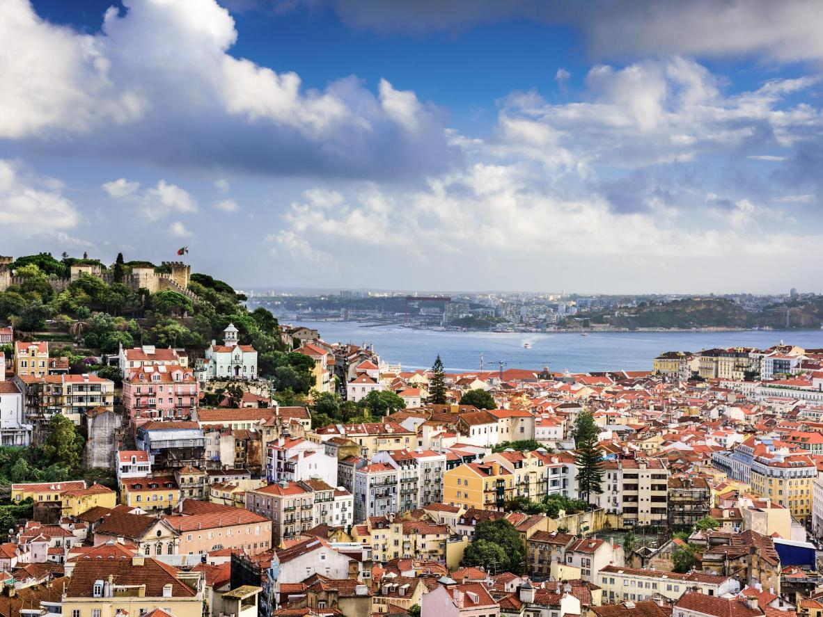 Enjoy a rooftop view in Lisbon as you work on your Bow Pose