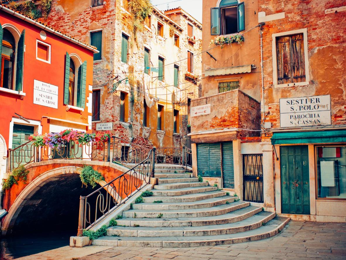 Painted shutters and floral bridges in Venice