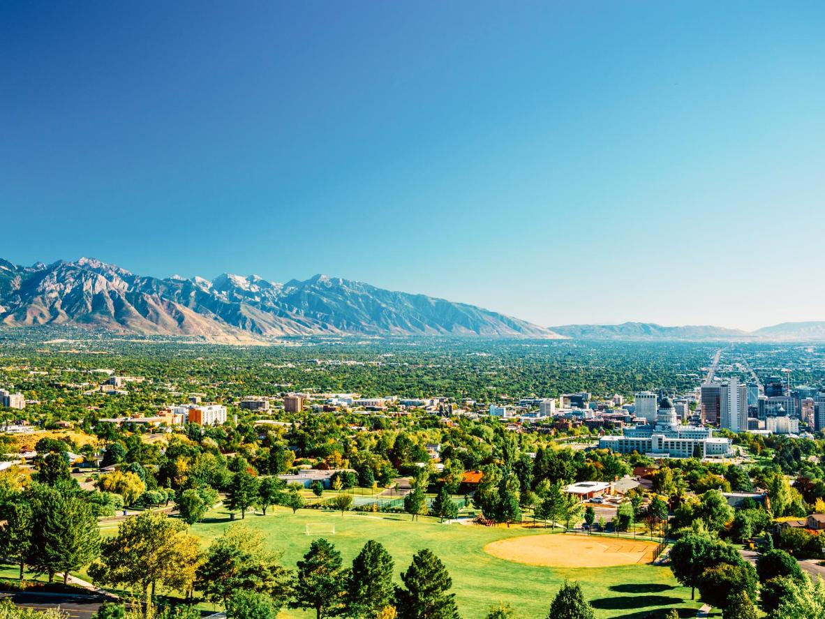 Salt Lake City's skyline, with the Wasatch mountain range in the distance