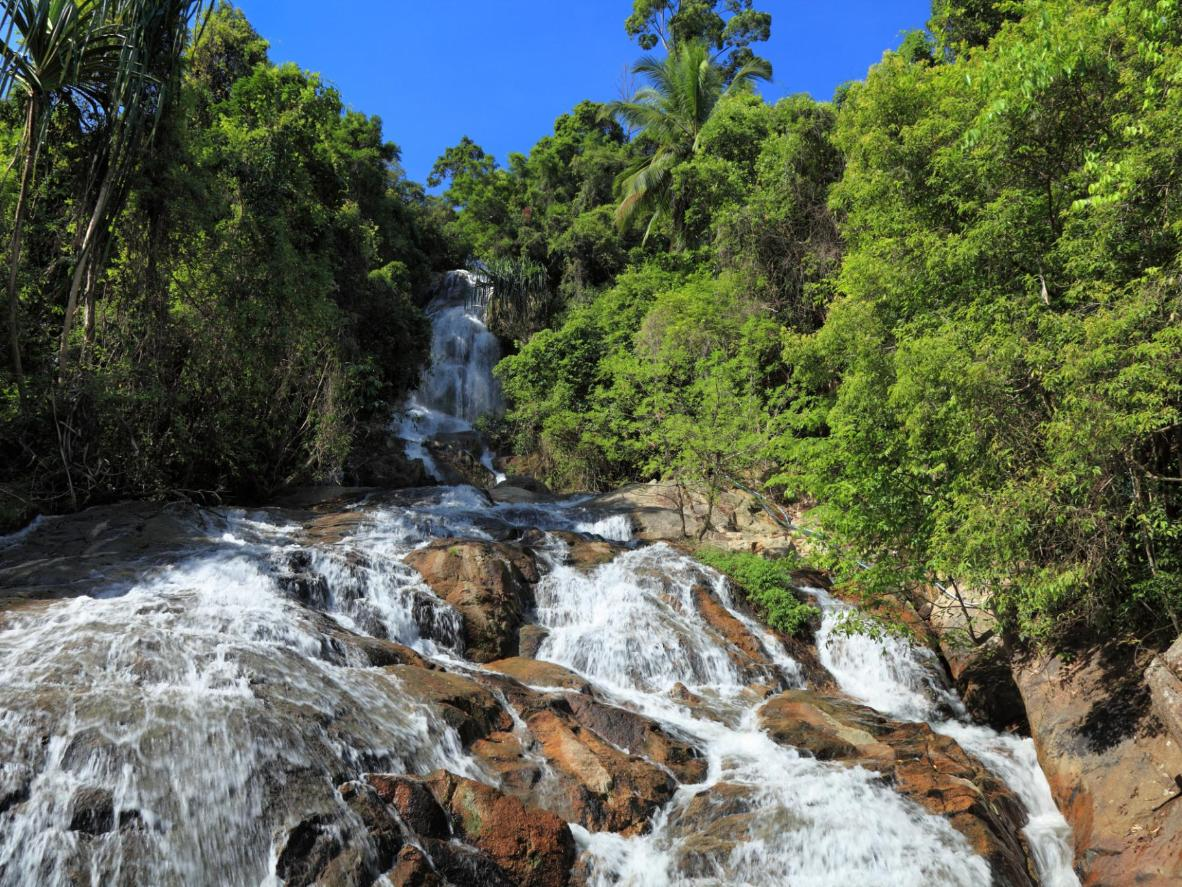 Na Mueang Waterfall, down the road from the Magic Alambic Rum Distillery