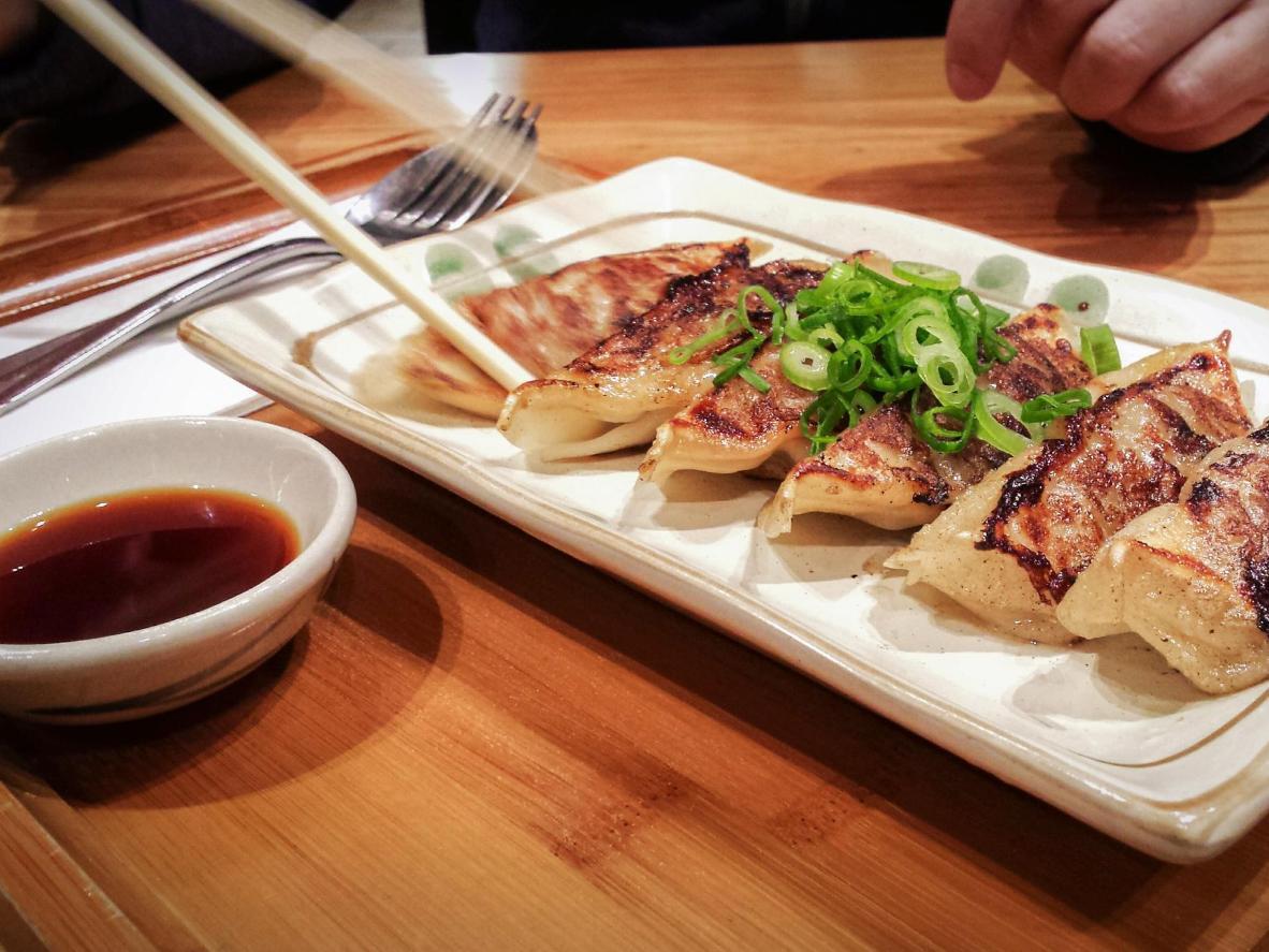 Fresh jiaozi in soy sauce