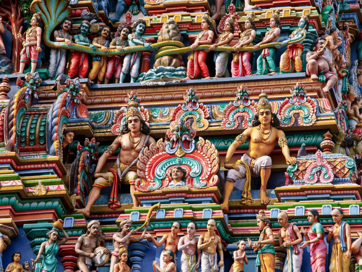 A temple wall in Kumbakonam depicts hundreds of brightly coloured deities