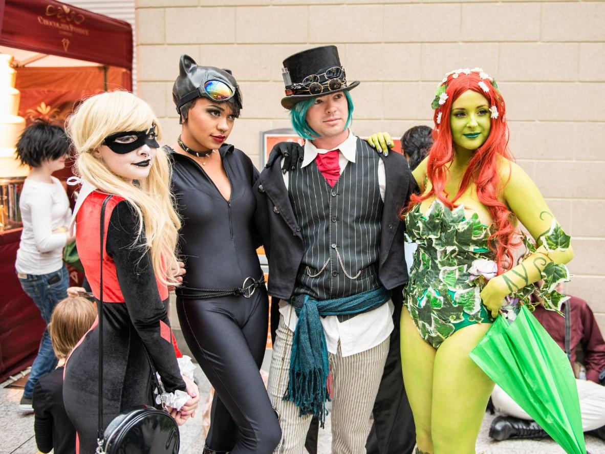 Cosplayers dressed as a Harley Quinn, Catwoman and Poison Ivy from Batman