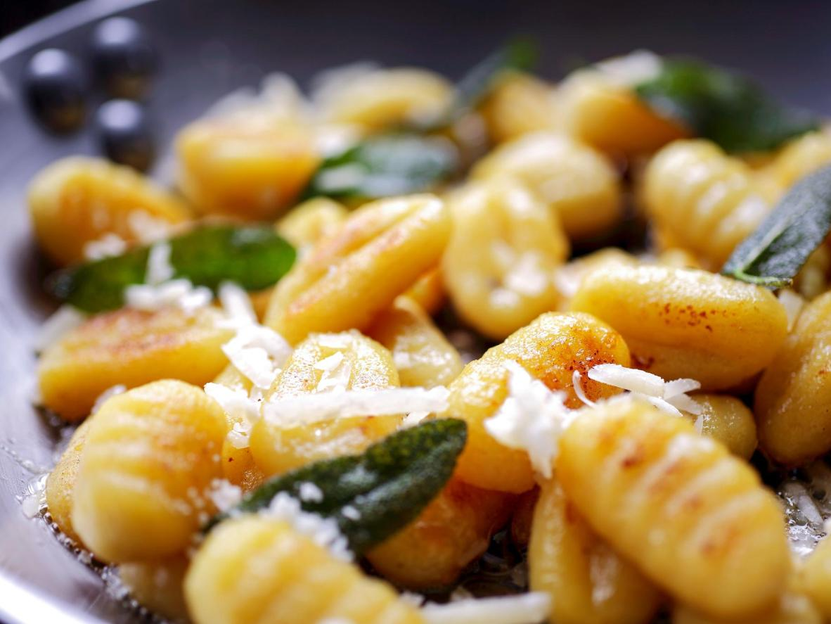 Gnocchi in butter and sage is served alongside seafood in northern Italy