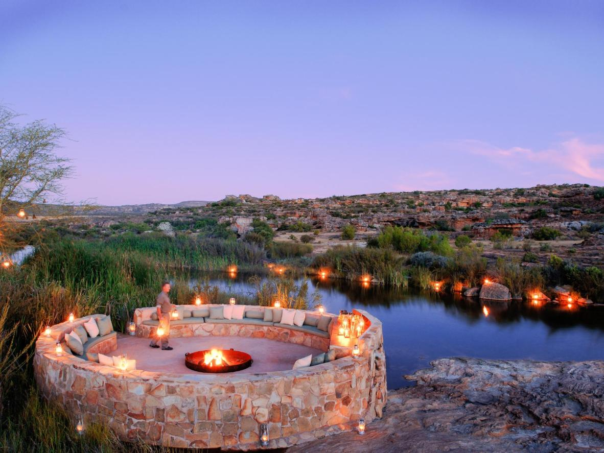 Watch the sunset, then stargaze by a campfire at Bushmans Kloof