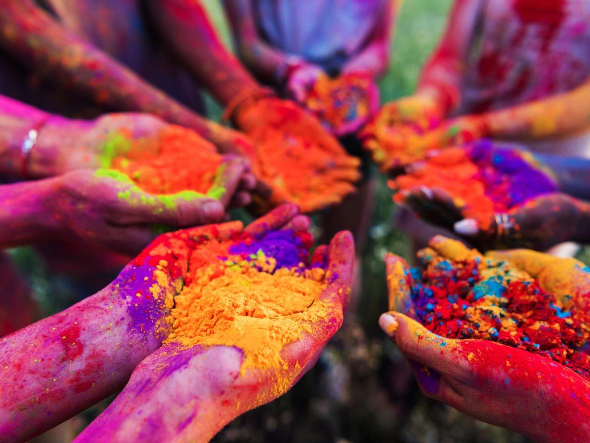 Dance to EDM and throw coloured powder in the air in Cape Town