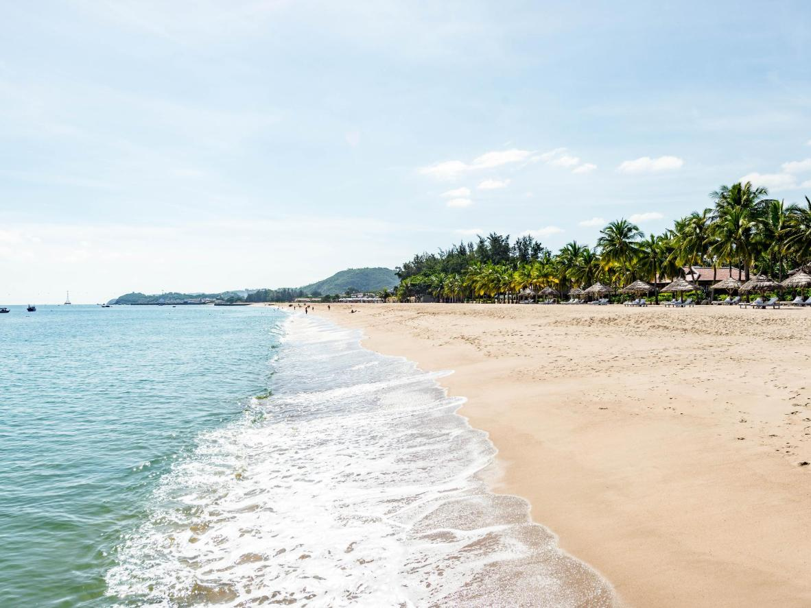Nha Trang's sandy beaches are lined with palm trees