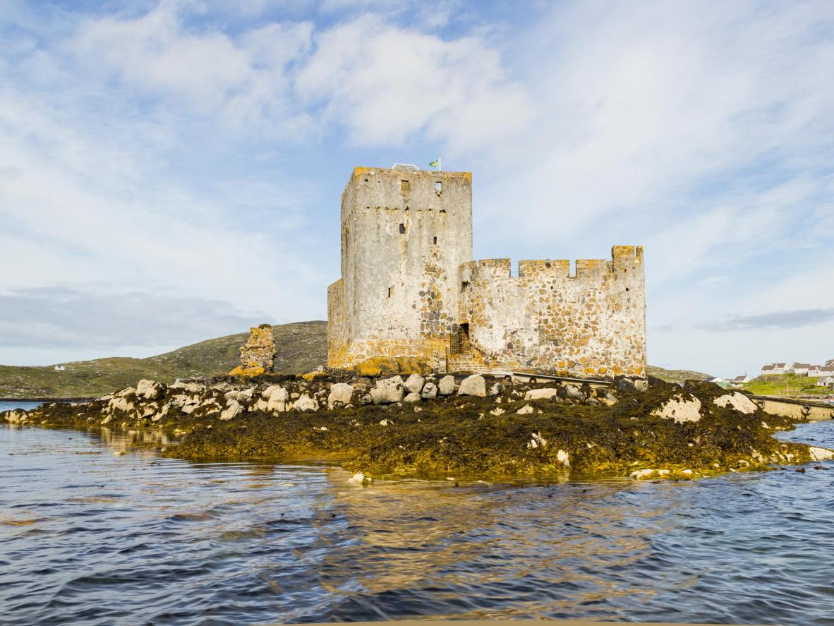 Kisimul Castle, a small medieval castle located on an islet in the centre of Castlebay on Barra