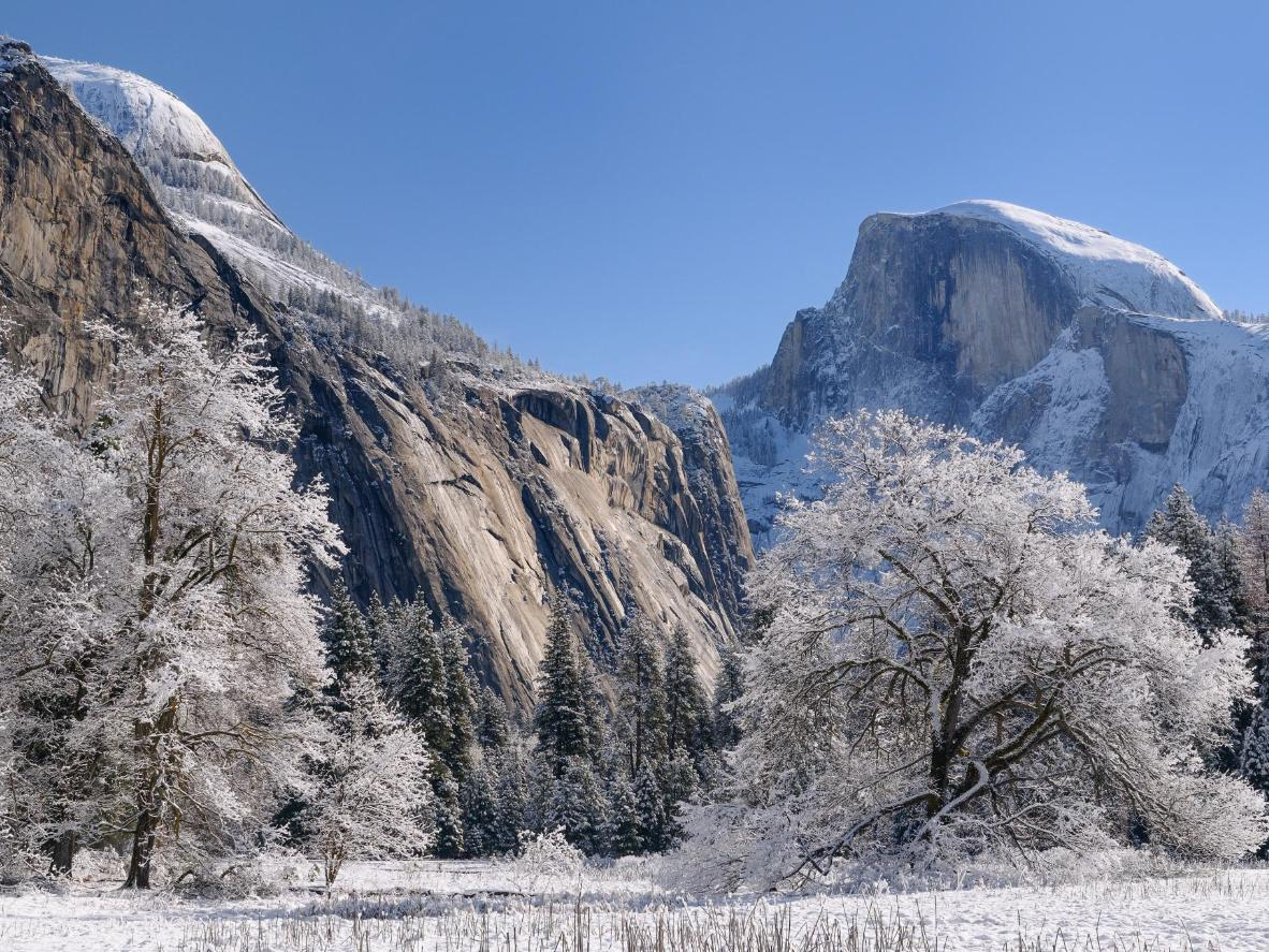 The iconic Half Dome and Glacier Point are visible from the rink