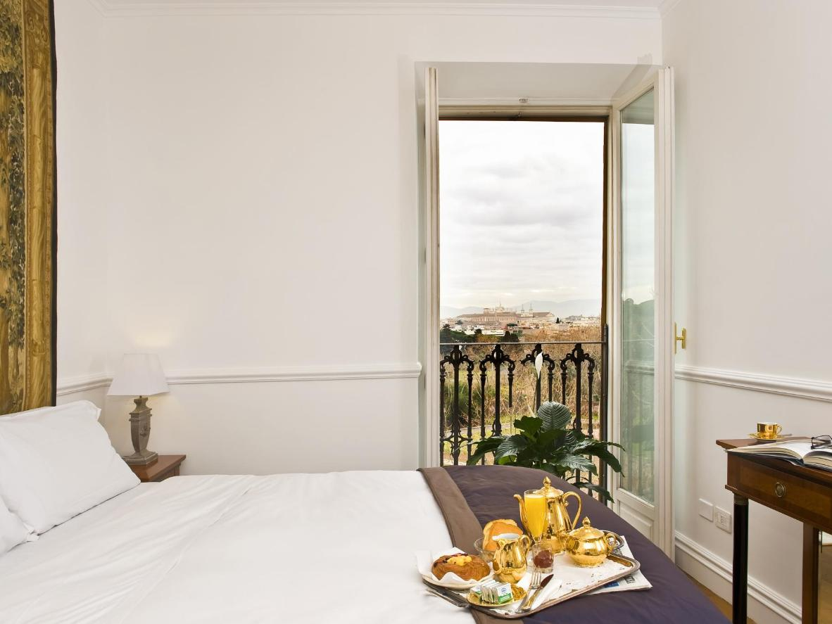 Wake up to a decadent breakfast and views over Ancient Rome.