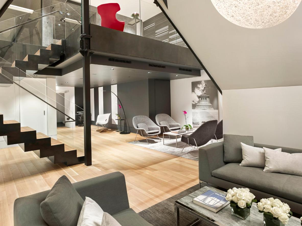 Rooms feature black-and-white photographs and a grey color scheme