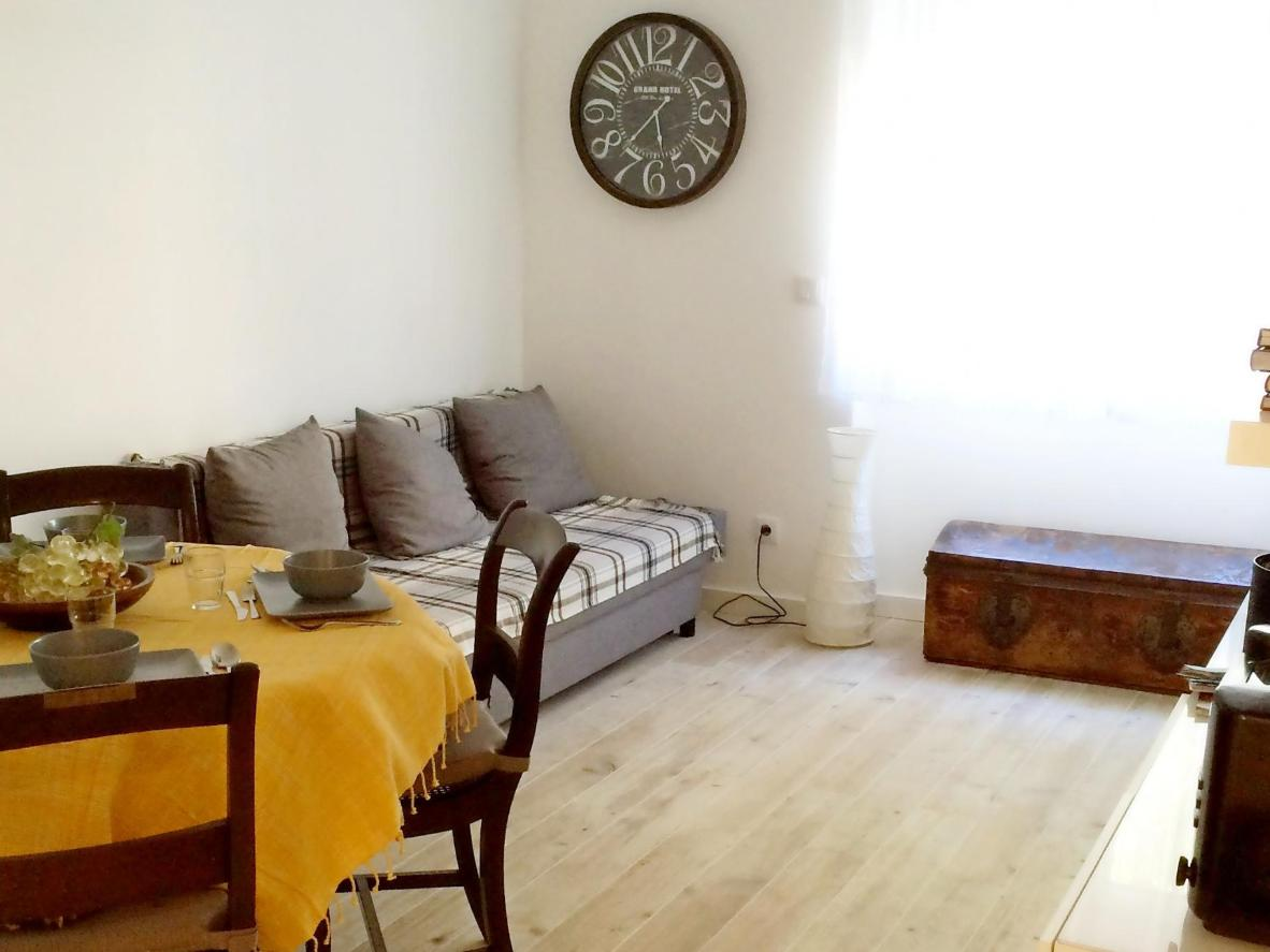 The homely apartment comes with everything you need to cook dinner