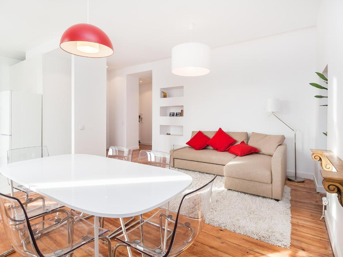 Punchy red pillows add some colour to the living room