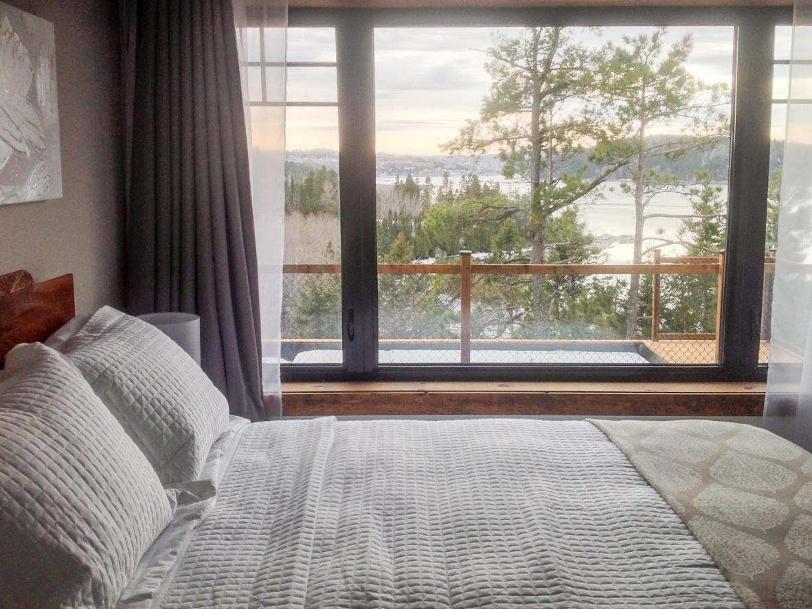 Wake up to a view across the River Saguenay before a dip in the heated outdoor pool