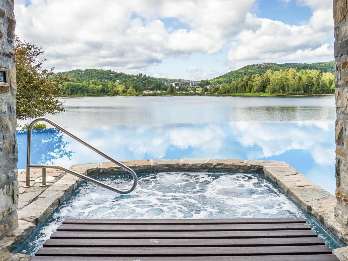 Look out over Lake Tremblant while you soak in the hot tub