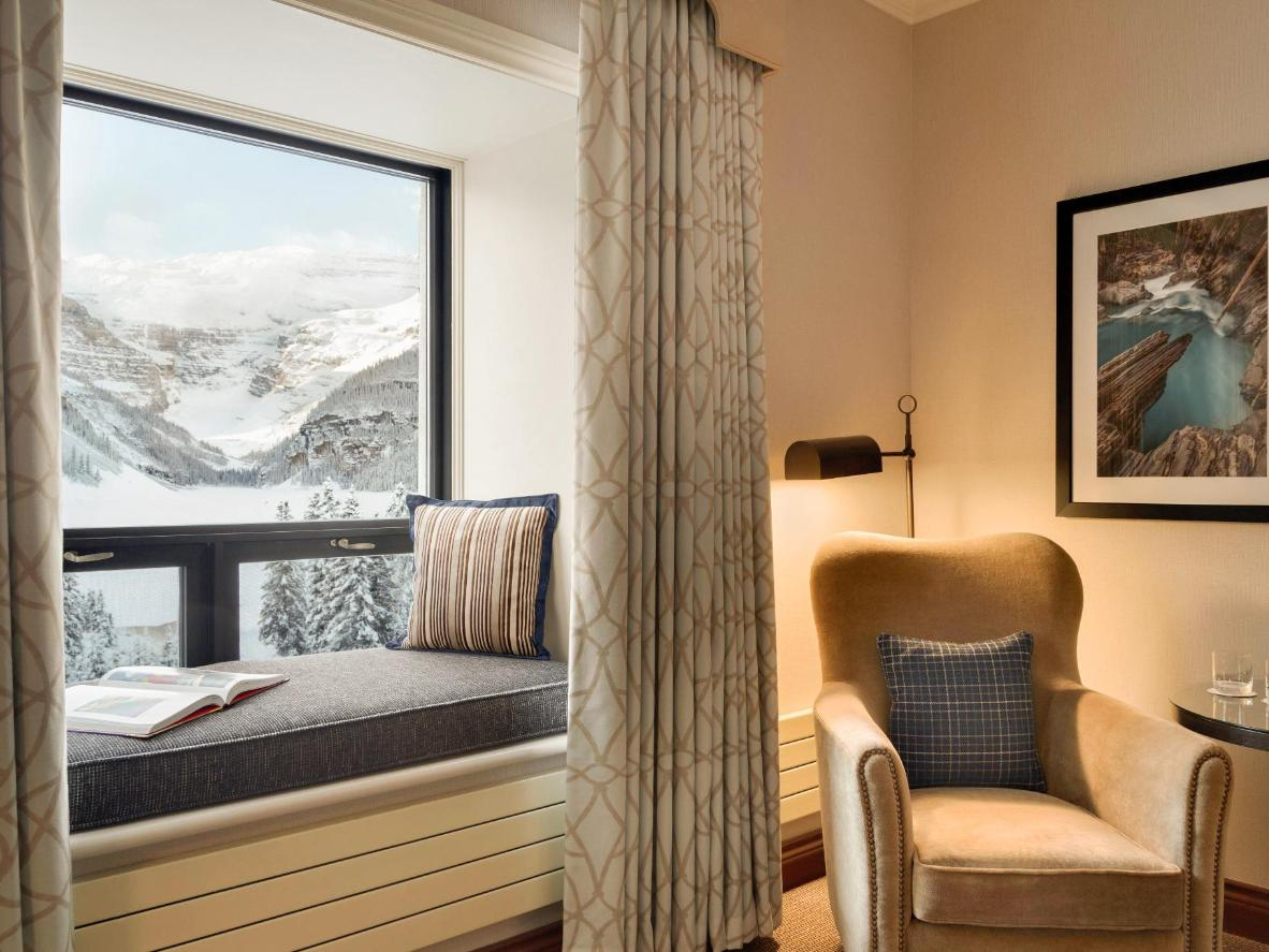 Cosy up with a book on your room's windowseat, complete with glacier views