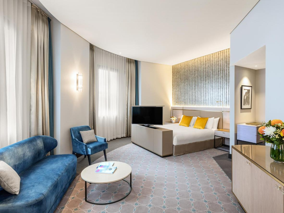 Contemporary furniture and light velvet accents can be found at Radisson Blu Plaza Hotel