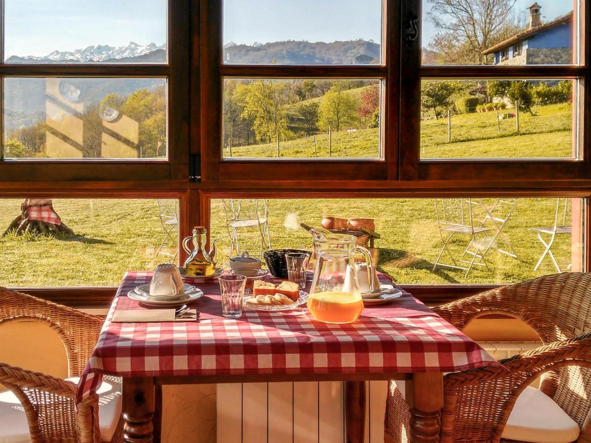 Admire the verdant Asturias over breakfast