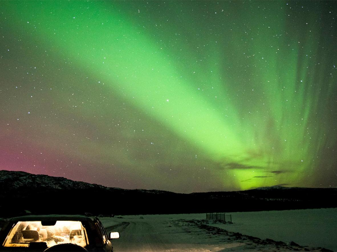 Cuddle up together in the car as the sky turns emerald