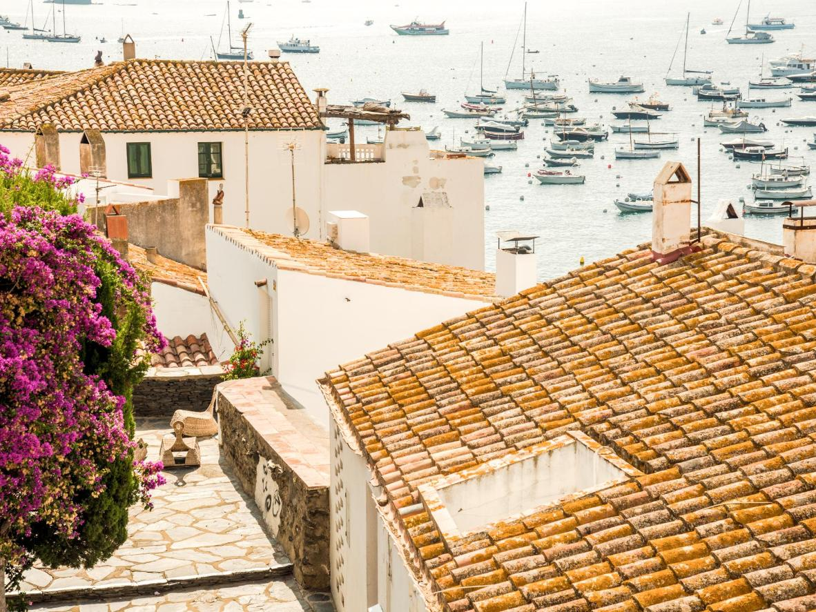 Navigate through a maze of arched walkways and narrow stone streets