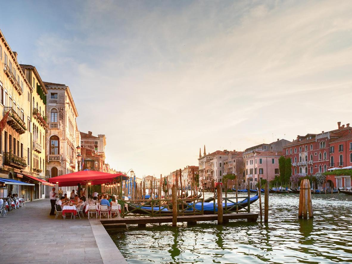 Sip on a Bellini while watching the sunrise, or set, over Venice's canals