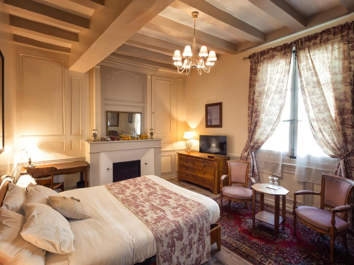 Sleep in one of the regal bedrooms at Au Relais Saint Maurice