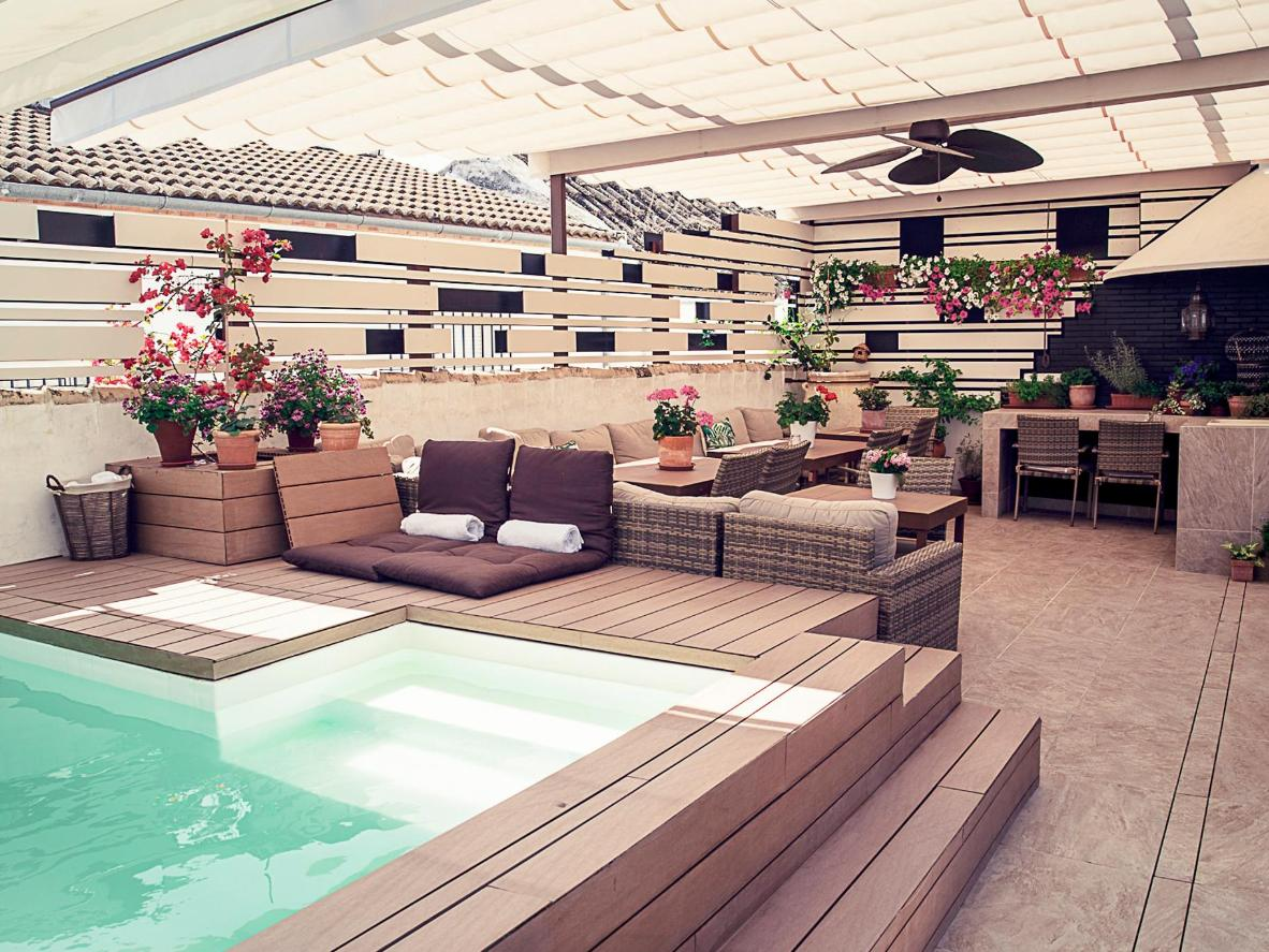 Part garden terrace and pool, it's a stylish space to lounge out on