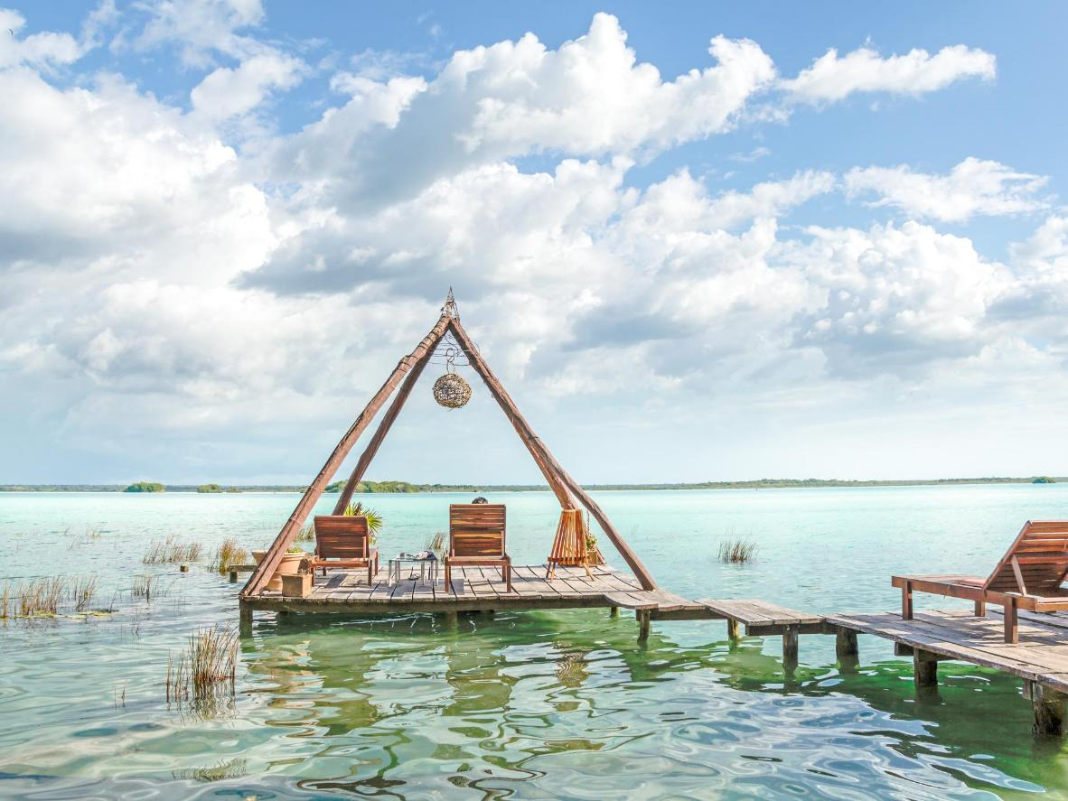 Lay out on one of the floating terraces and look out over the turquoise lake