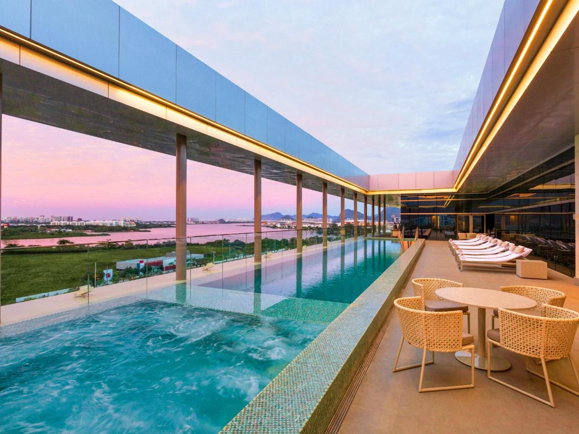 See pastel sunset skies through the Hilton pool's state-of-the-art sunroof
