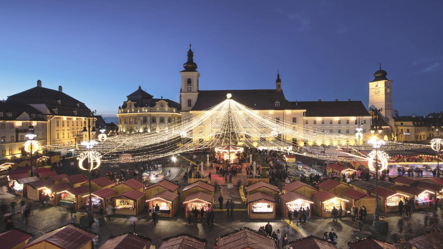 Stalls fill the Baroque square in Sibiu, while the aroma of spiced wine fills the air