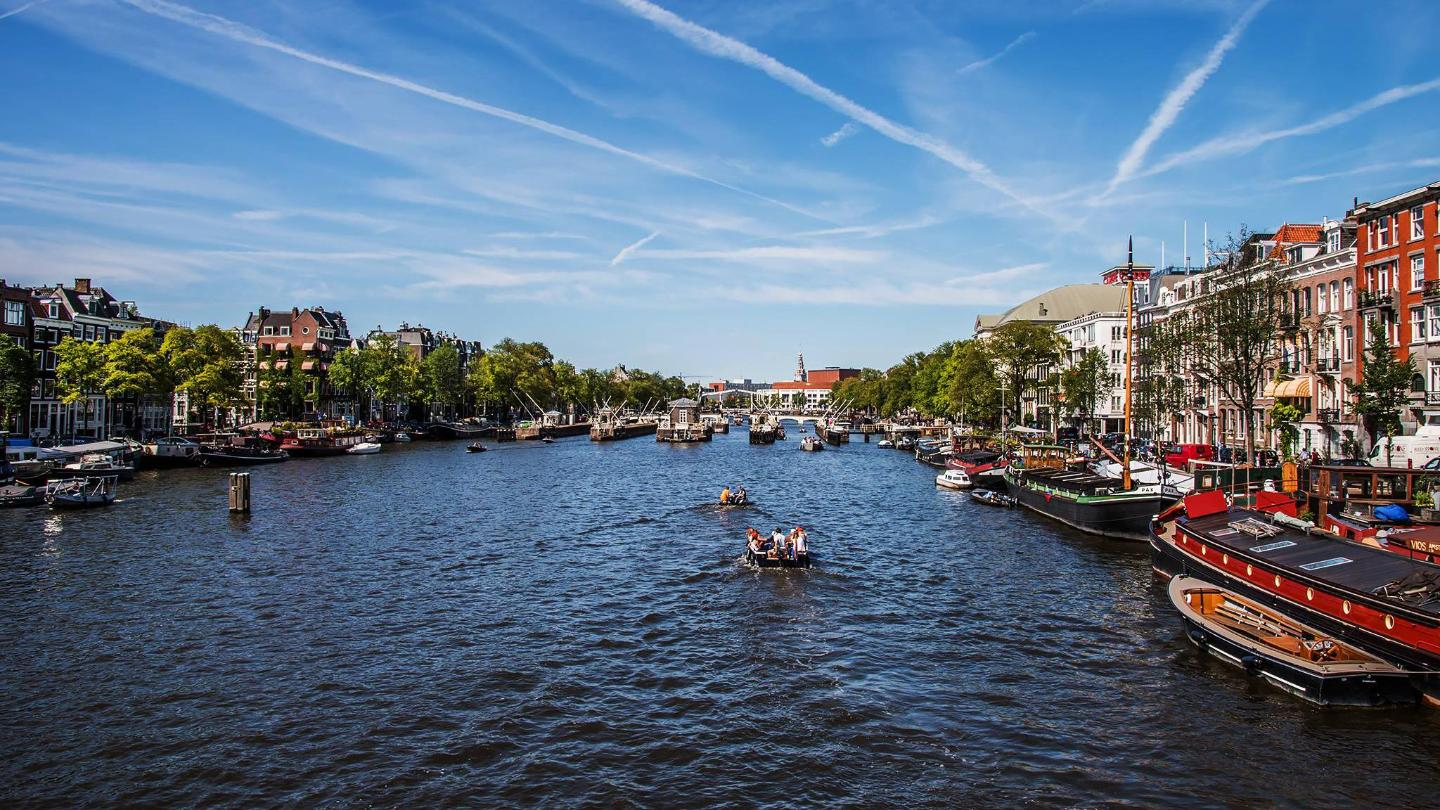 Hit the streets or one of the waterside cafés to bask in the warm Amsterdam summer weather