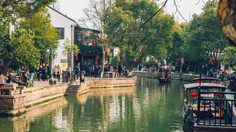 A canal boat navigates through the lantern-laden waterways of Zhujiajiao