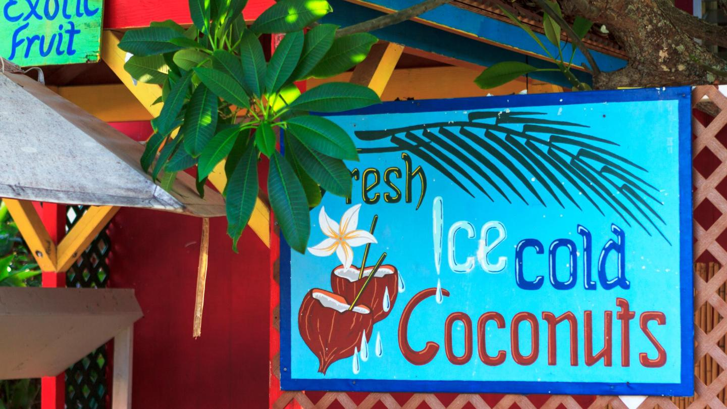 A sign advertising fresh coconut drinks in Kaua'i