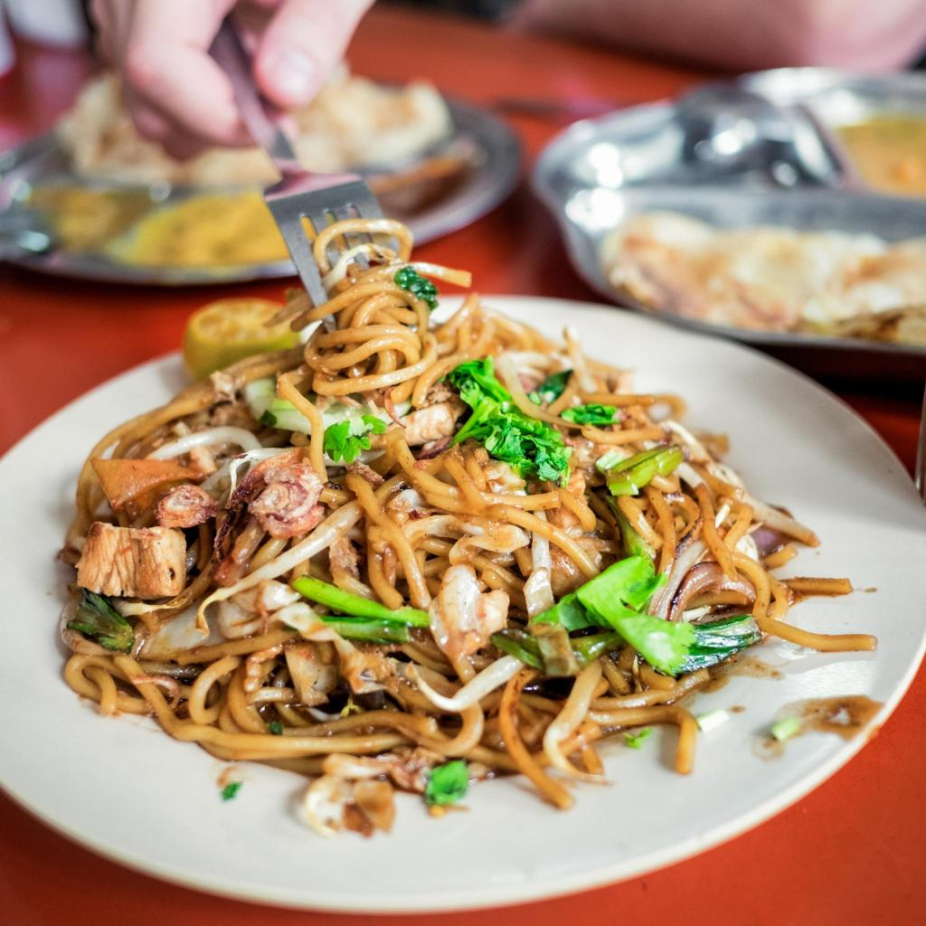 Try some juicy, soy-drenched noodles stir-fried for you on the spot in Penang