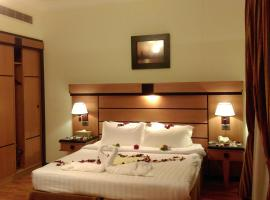 Avail Grand Hotel & Suites