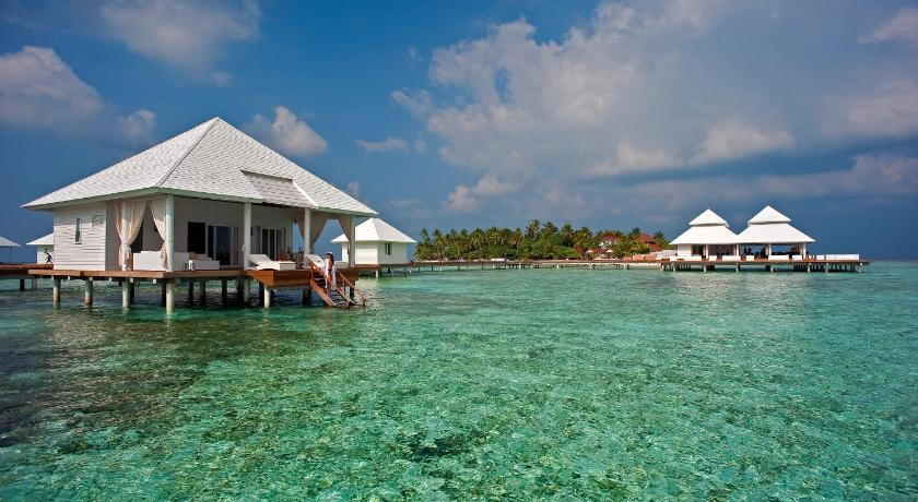 Over-water villas feature a large terrace offering direct access to the lagoon.