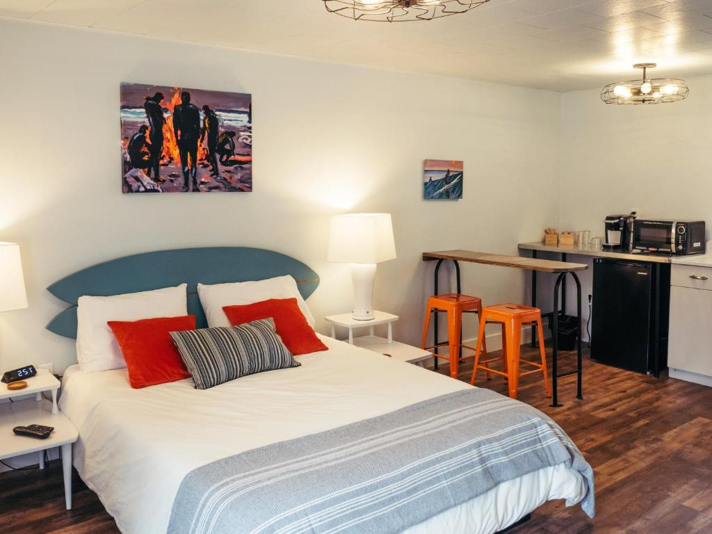 A bed or beds in a room at LOGE Westport