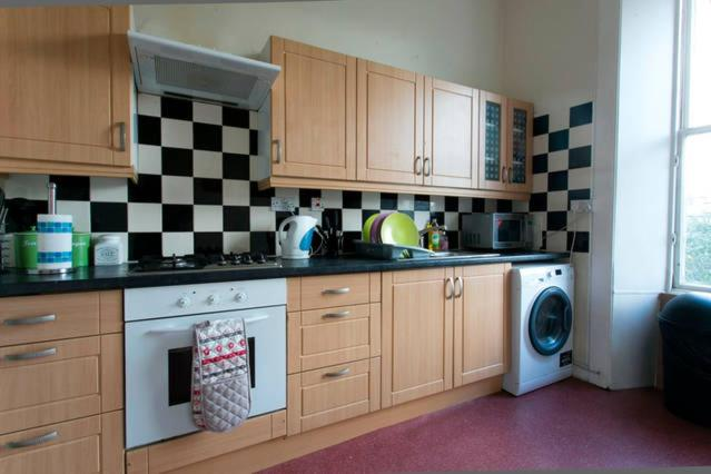 A kitchen or kitchenette at Syozant Lauriston Central ApartHotel